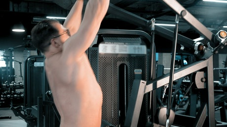 Bodybuilder doing exercises at the gym