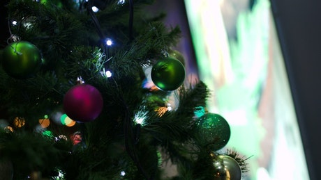 Bokeh lights through a Christmas tree