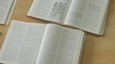 Books open wide for reading on a table