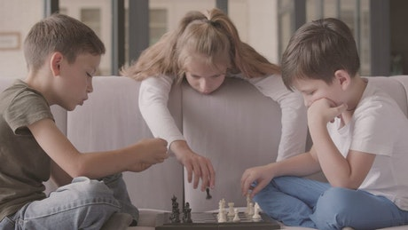 Bored kids playing chess