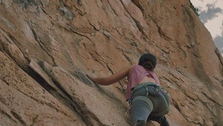 Bottom view of a girl climbing a mountain
