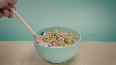 Bowl with sugary cereal with marshmallows and milk