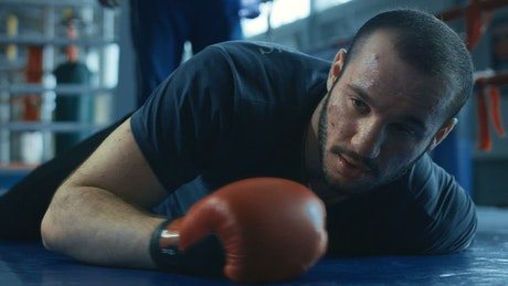 Boxer awakening from a knockdown