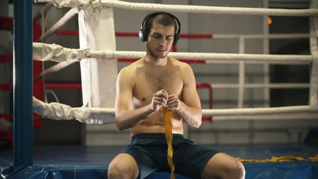 Boxer preparing for his training next to the ring