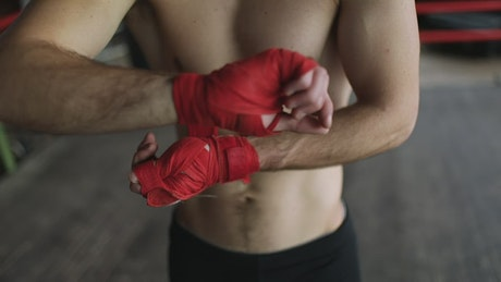 Boxer wraps hands to prepare for training