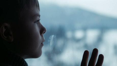 Boy behind the window