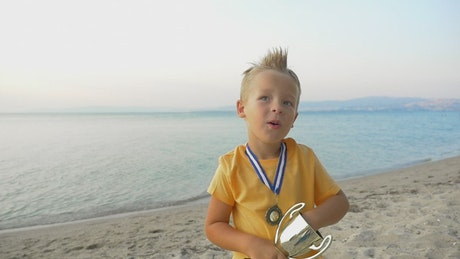 Boy celebrating with his trophy