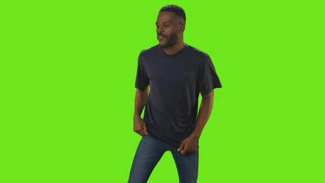 Boy dancing funnily on a green chroma background