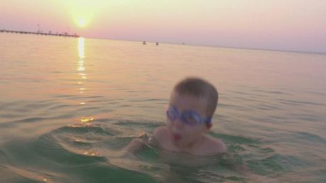 Boy jumping in the ocean