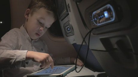 Boy playing a game while flying