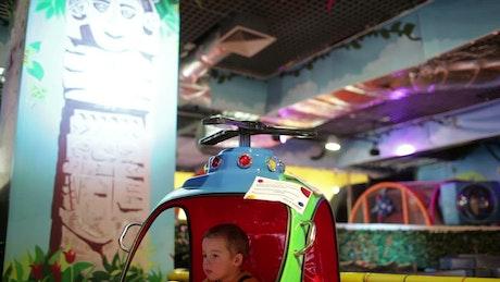 Boy playing at an arcade