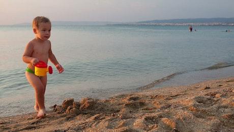 Boy playing at the seashore