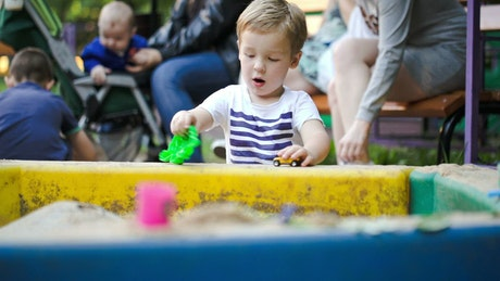 Boy playing in a sand box