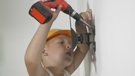 Boy playing with a toy drill