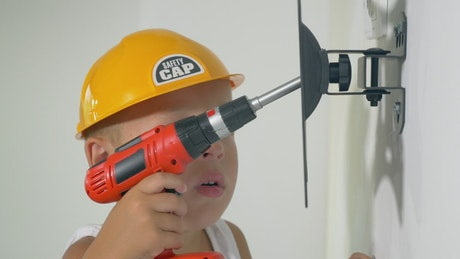 Boy playing with toy tools