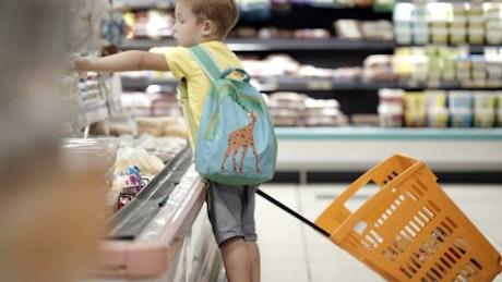 Boy pulling a shopping cart