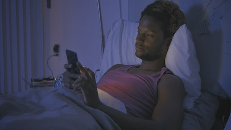 Boy puts his cell phone aside so he can go to sleep