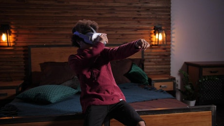 Boy scared while playing in VR