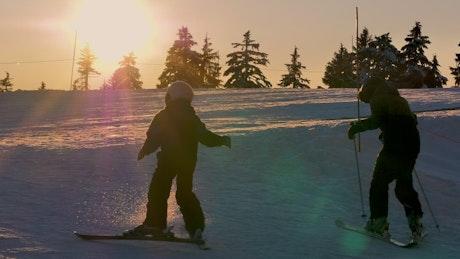 Boy skiing during sunrise