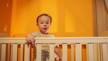 Boy smiling in an orange room