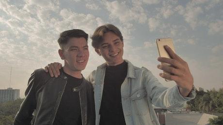 Boyfriends taking selfies