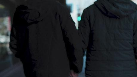 Boyfriends walking together in the street