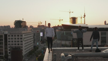 Boys enjoying the view of the city on the rooftop