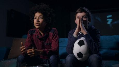 Boys watching a football match