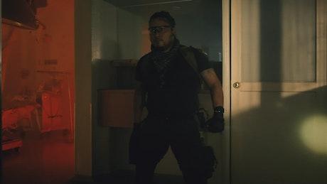 Brave armed mercenary in an abandoned hospital