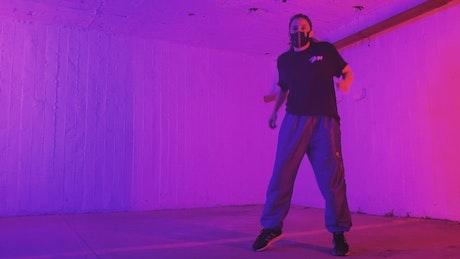 Break dance dancer with muzzle in dim light