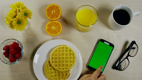 Breakfast pancakes with a phone