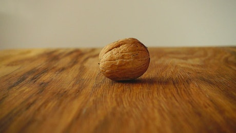 Breaking a walnut with hammer