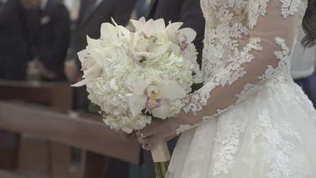 Bride at her wedding holding bouquet