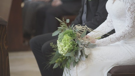 Bride with her bouquet during her wedding ceremony