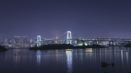 Bridge and boats at night, time-lapse