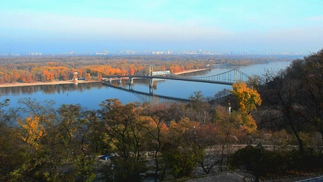 Bridge between Autumn trees