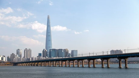Bridge of a bullet train crossing the lake of a city