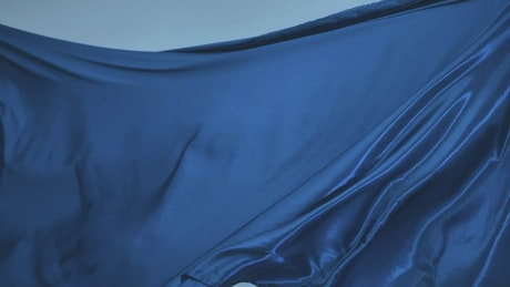 Bright blue fabric texture moving with the wind