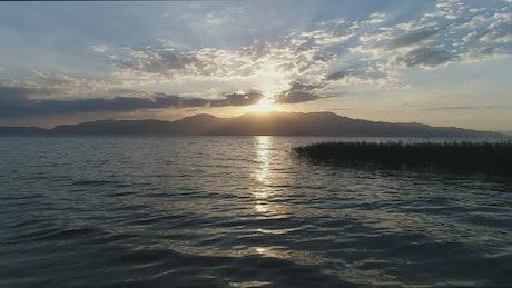 Bright sunset across a calm ocean