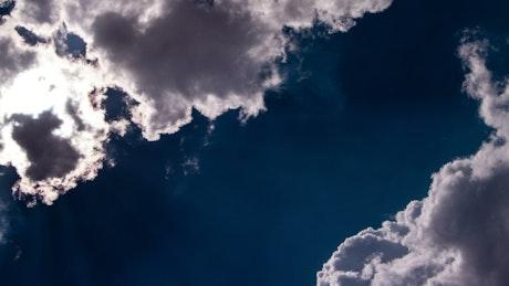 Bright sunshine hidden behind a cloud
