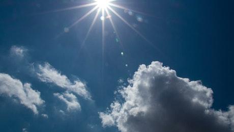 Bright sunshine through thick clouds