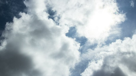 Bright sunshine through thin clouds