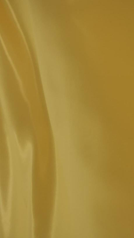 Bright yellow fabric waving