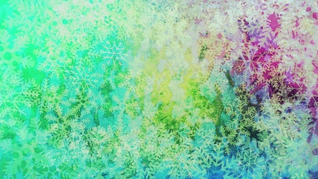 Brightly colored snowflakes in motion
