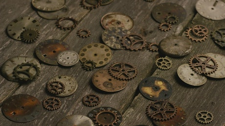 Broken clocks and gears on the table