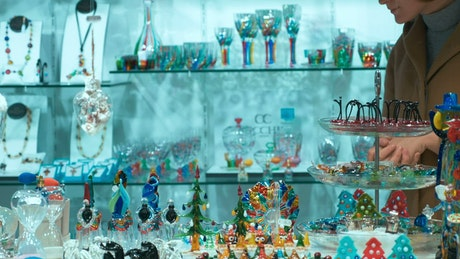 Browsing glass products in a shop
