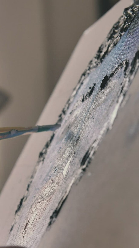 Brush of an artist painting artwork in slow motion