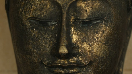 Buddha face from a metal statue