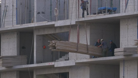 Builders working at the construction site