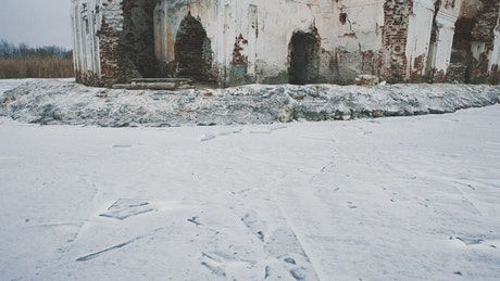 Building ruins covered in snow